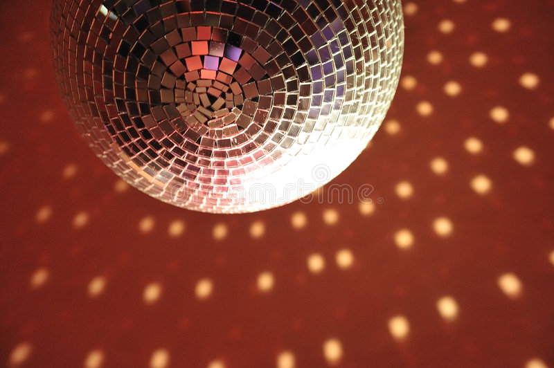 Discotheque light ball luminary on red ceiling. Thousands of mirror royalty free stock photography