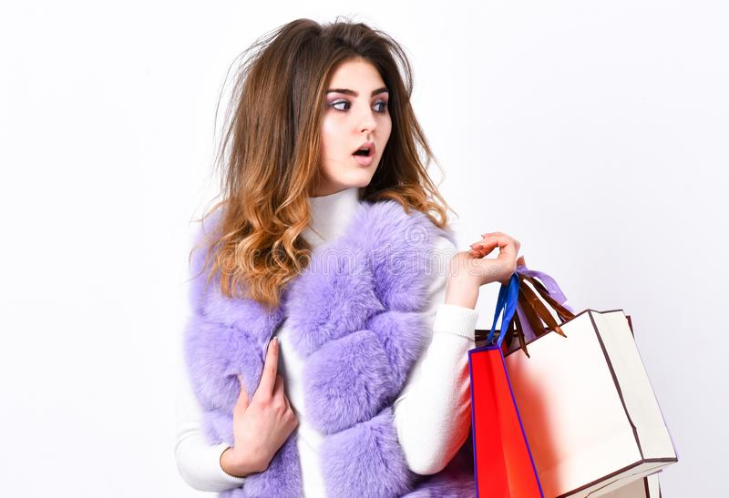 Discount black friday. Shopping and gifts. Fashionista buy clothes on black friday. Girl makeup furry violet vest. Shopping white background. Woman shopping stock photos