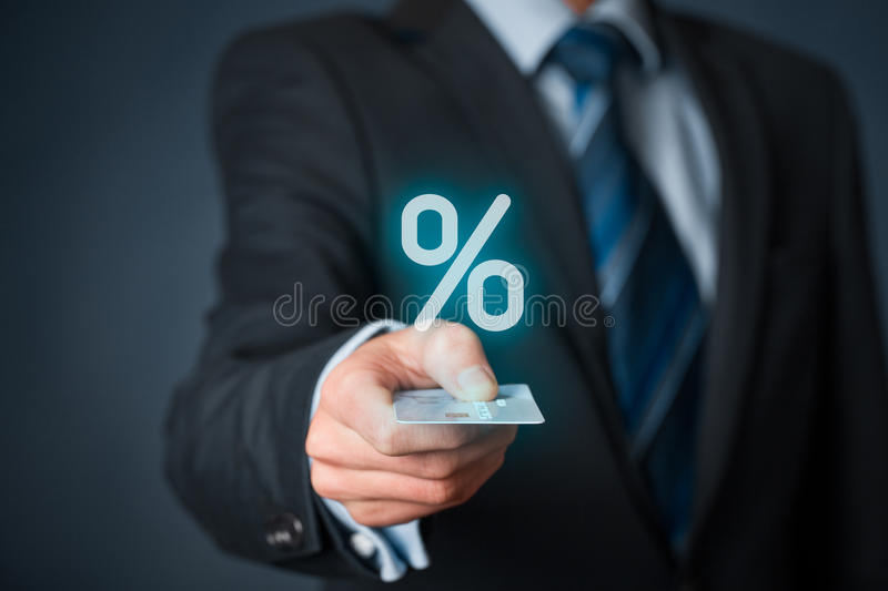 Discount and commission. With cashless (credit card) payment. Businessman with credit card and percentage symbol stock photo
