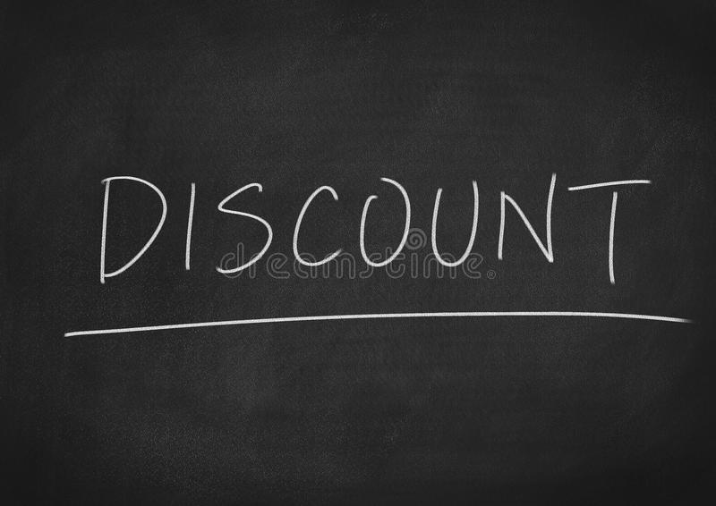 Discount. Concept word on blackboard background royalty free stock photography