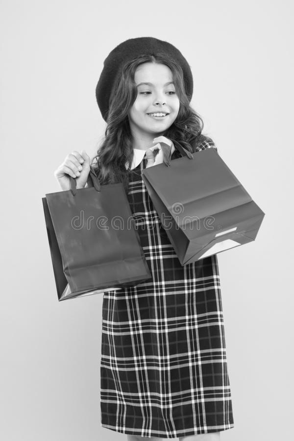 Discount. little girl in french style hat. happy girl with long hair in beret. little beauty shopaholic. Holiday present. Shopping. child with shopping bag stock image