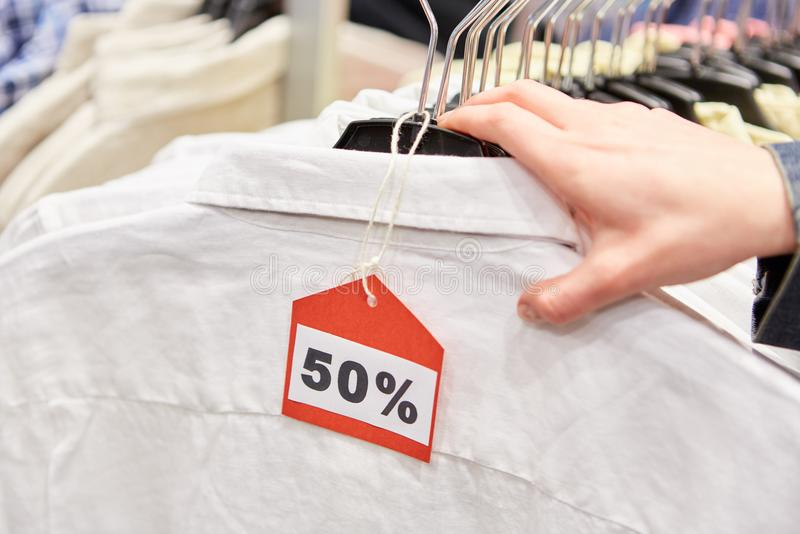 50% discount Discount in retail. Hand on clothes with 50% discount Discount on retail in a shop stock photos