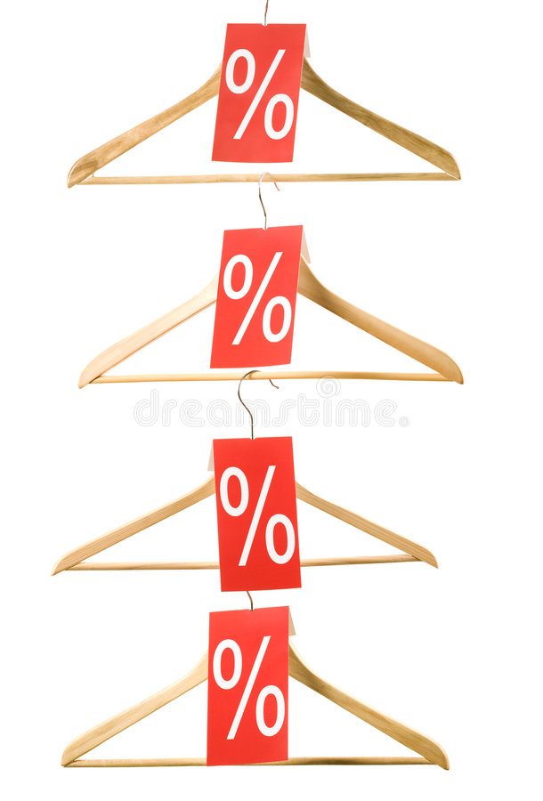 Discount on sale. Image of wooden hangers with sale discount red checks on white background royalty free stock photo