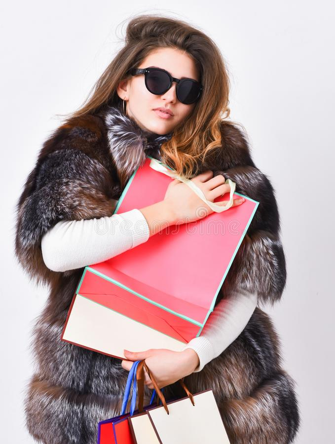 Discount and sale. Buy with discount on black friday. Shopping with promo code. Woman shopping luxury boutique. Girl. Wear sunglasses and fur coat shopping royalty free stock images