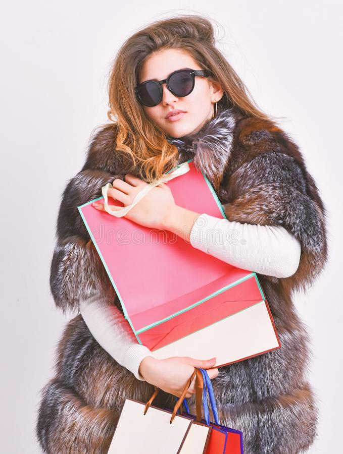 Discount and sale. Buy with discount on black friday. Shopping with promo code. Woman shopping luxury boutique. Girl. Wear sunglasses and fur coat shopping royalty free stock photography