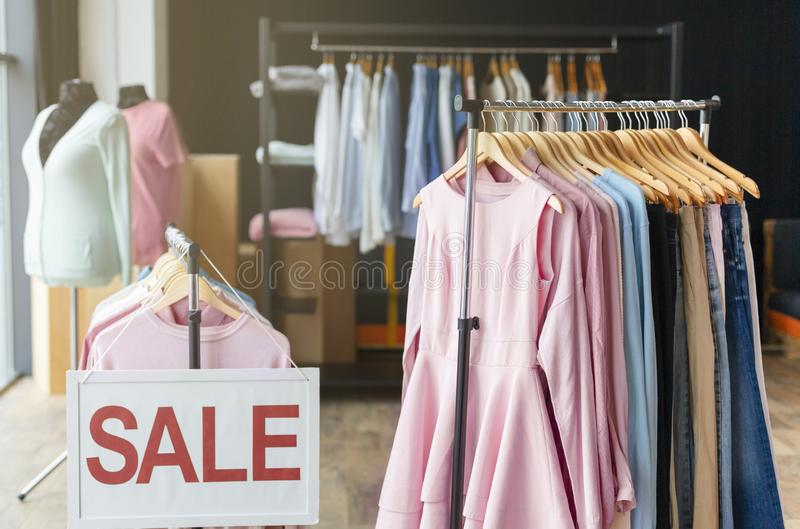 Discount sale sign in shopping mall clothing store. Big sale. Discount sale board in shopping mall, clothing department, copy space stock photos