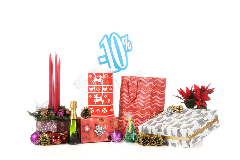Discount sign above Christmas shopping. Ten percent discount sign above Christmas shopping's on reflective surface. Studio shot. White background stock photos