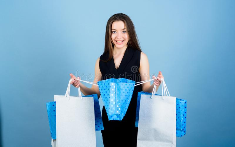 Discount and special offer. Black friday shopping. Obsessed with purchase. Beautiful woman with shopping bags smile royalty free stock photo