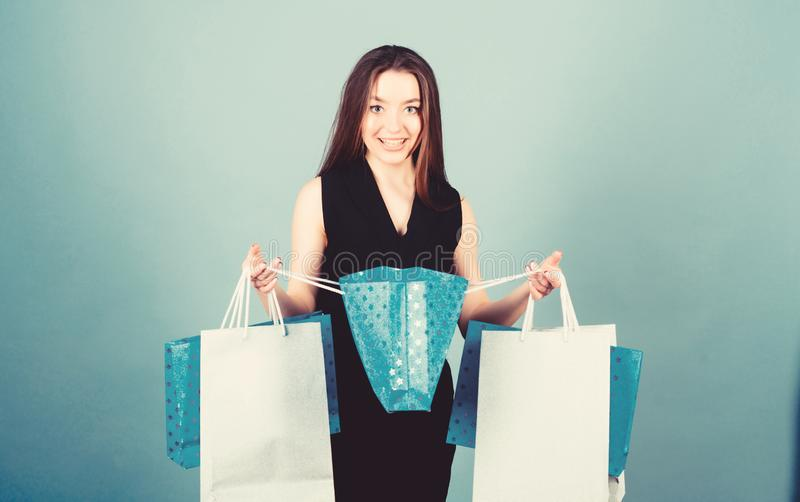 Discount and special offer. Black friday shopping. Obsessed with purchase. Beautiful woman with shopping bags smile stock image