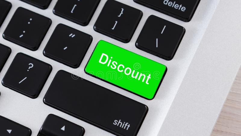 Discount word on button of laptop keyboard stock illustration