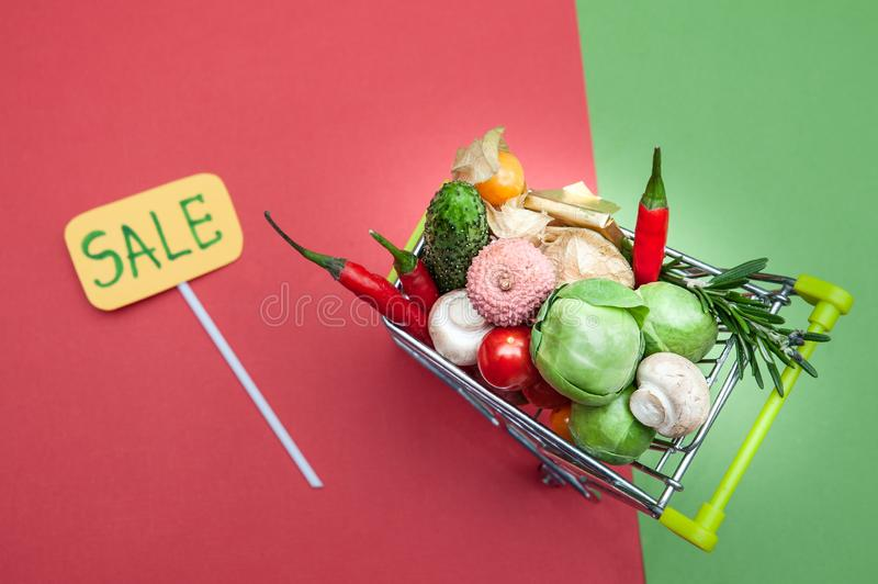 Discounts for healthy products concept. Shopping cart in supermarket full of fruits and vegetables stock photo