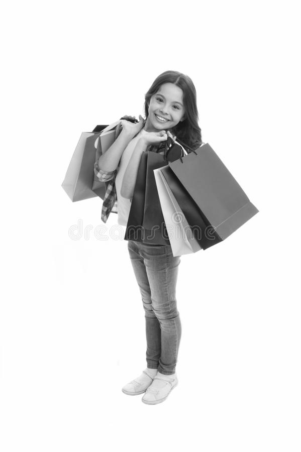 Discounts and promo codes. Girl carries shopping bags isolated on white background. Girl fond of shopping. Child cute. Shopaholic with bunch shopping bags black stock photos
