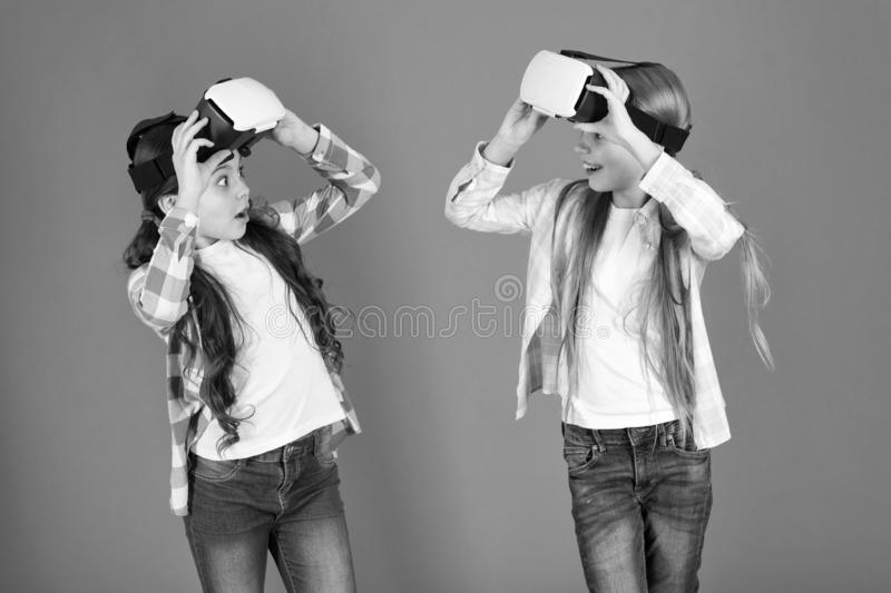 Discover virtual reality. Kids girls play virtual reality game. Friends interact in vr. Explore alternative reality. Future is present. Cyber space and virtual stock photos