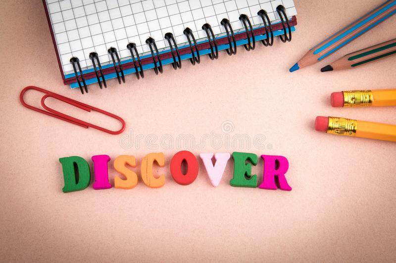 Discover. Wooden letters on the office desk stock photos