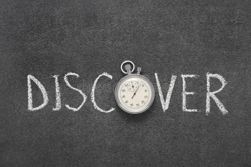 Discover word watch. Discover word handwritten on chalkboard with vintage precise stopwatch used instead of O royalty free stock photo