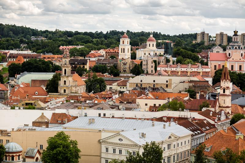 Discovering Vilnius old town. Vilnius old town architecture. Unique heritage of mixed architectural styles. Red roofs buildings in Vilnius stock images