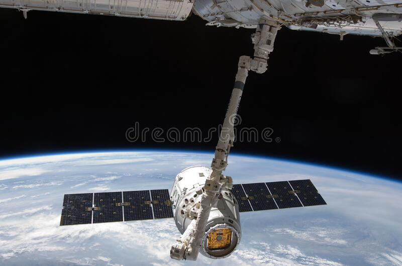 Discovery space shuttle on International Space Station stock photos