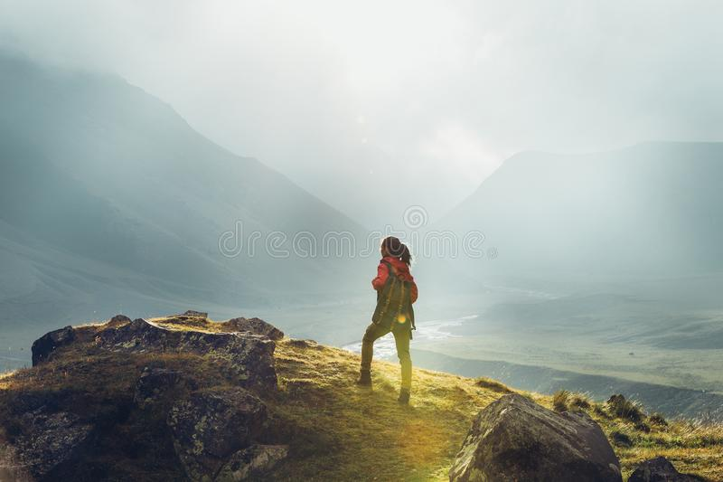 Discovery Travel Destination Holiday Concept. Hiker Woman With B. Ackpack Rises To The Mountain Top Against Backdrop Of Sunset Landscape, Rear View royalty free stock images