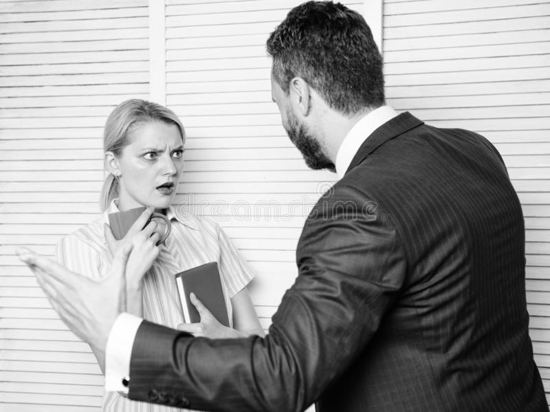Discrimination concept. Prejudice and personal attitude to employee. Tense conversation or quarrel between colleagues. Boss discriminate female worker royalty free stock image