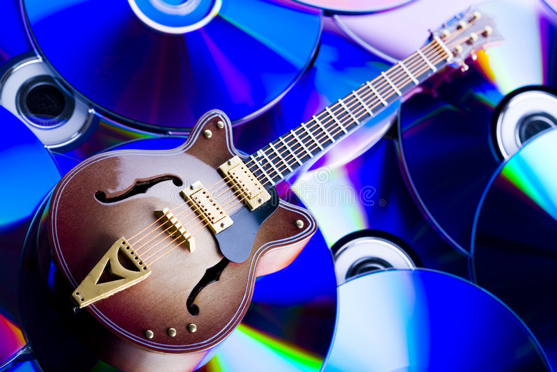 Discs and guitar. Musical instrument - classic guitar and other objects royalty free stock images