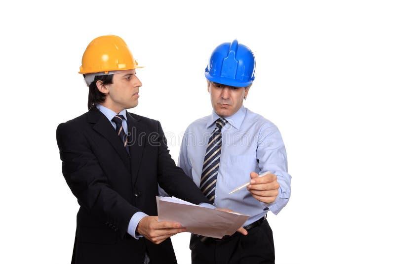 Discusión de los hombres de negocios imagenes de archivo