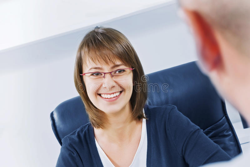 Discuss. Portrait of young business people discussing project in office environment stock image
