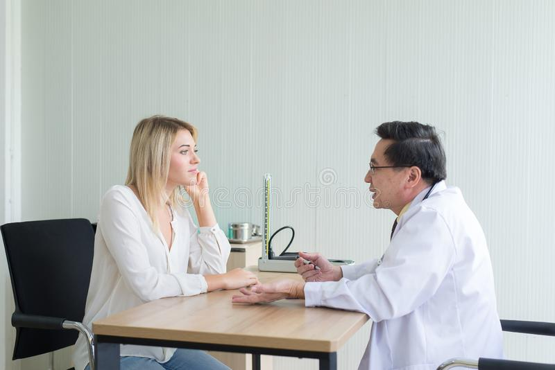 Discuss issue and find solutions to mental health problems,Woman talking to doctor psychiatrist in hospital. Discuss issue and find solutions to mental health royalty free stock photo