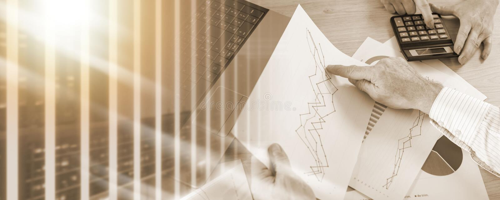 Discussing business graphs; multiple exposure royalty free stock image