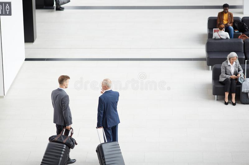 Discussing business trip in airport royalty free stock photos