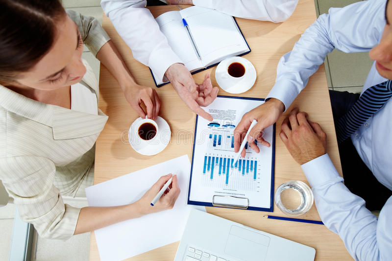 Discussing charts stock photography