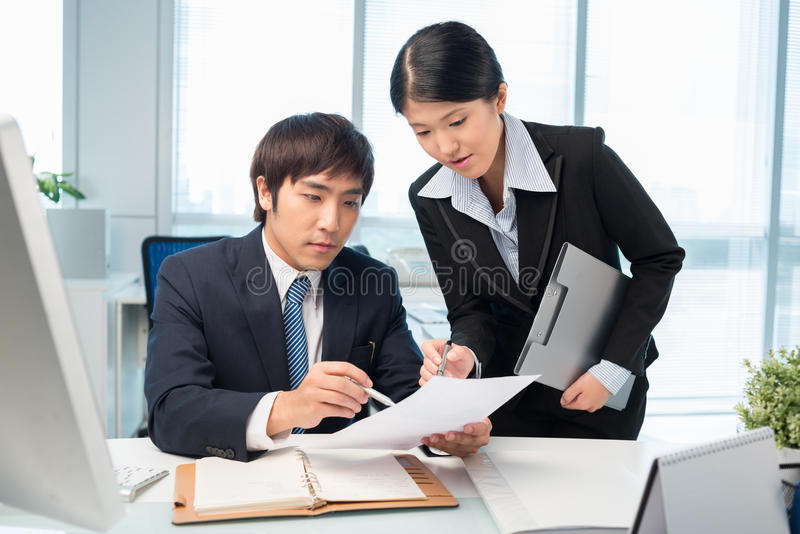 Discussing document royalty free stock image