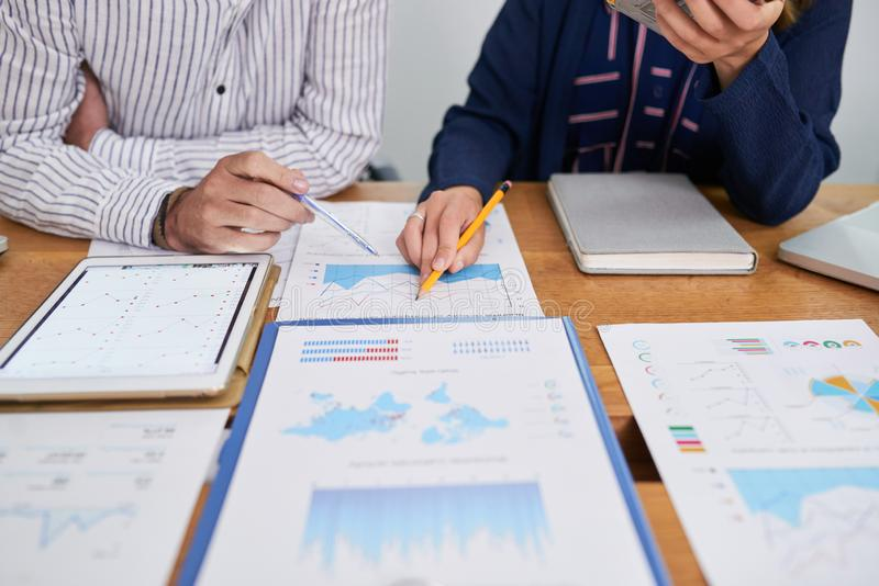 Discussing financial charts royalty free stock photos