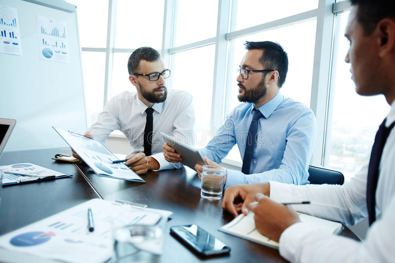 Discussing financial data stock photo