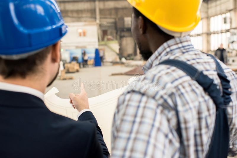 Discussing Manufacturing Process with Superior stock photo