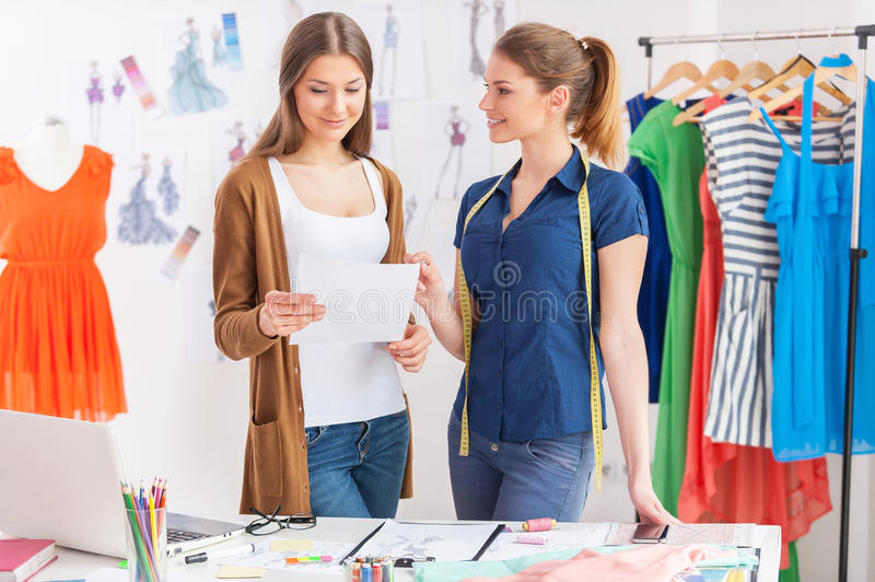 Discussing new fashion look. stock image