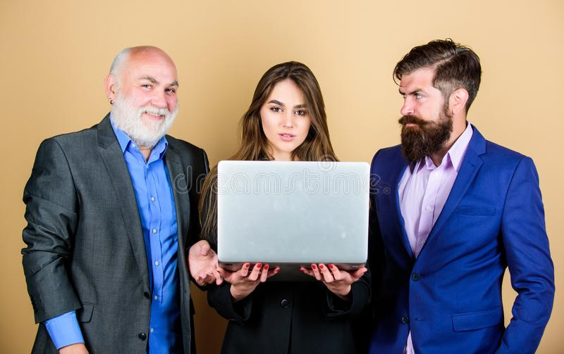 Discussing progress. Expert team. Business meeting. Men bearded manager show financial report laptop. Business plan stock photo