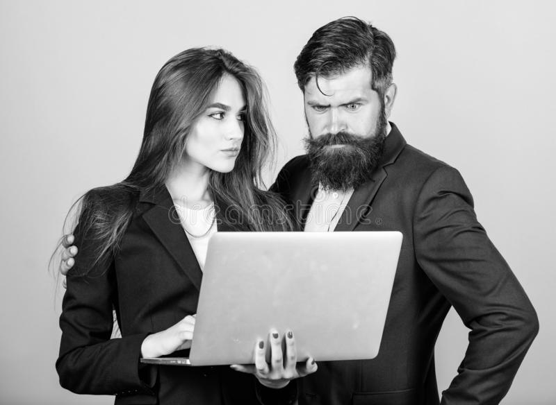 Discussing progress. Woman and guy colleague working together. Business plan. Business lady and director or boss surfing royalty free stock photos