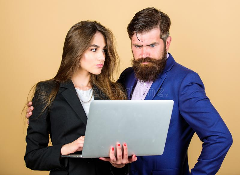 Discussing progress. Woman and guy colleague working together. Business plan. Business lady and director or boss surfing royalty free stock images
