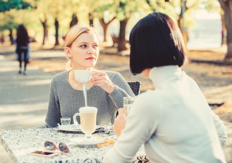 Discussing rumors. Trustful communication. Friendship sisters. Friendship meeting. Female leisure. Girls friends drink royalty free stock photo
