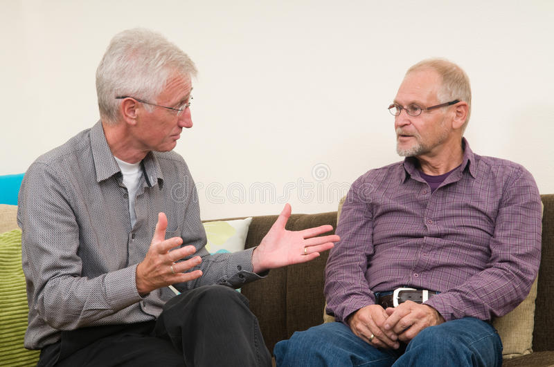 Discussing Seniors stock photography