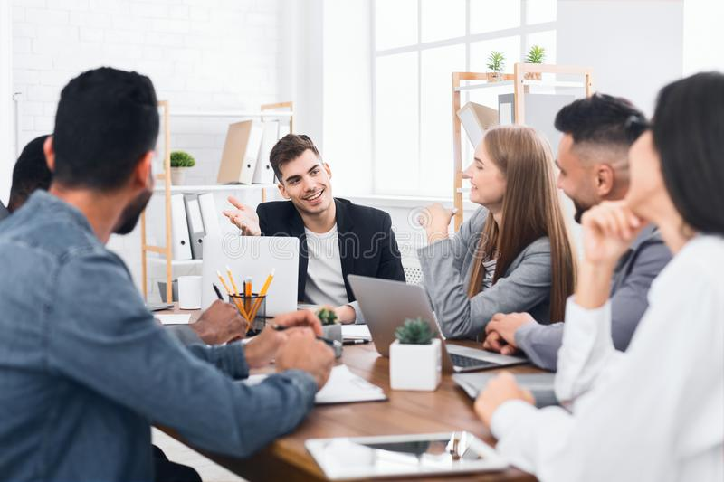 Group of young business people working and communicating royalty free stock photos