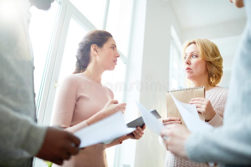 Discussing Work Results with Colleagues royalty free stock photos