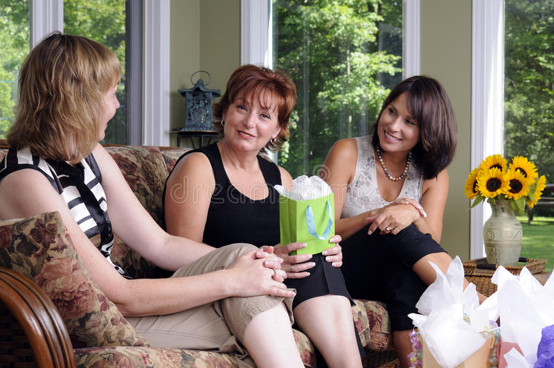 Discussion. Three Women At A Home Party Having A Discussion royalty free stock photography