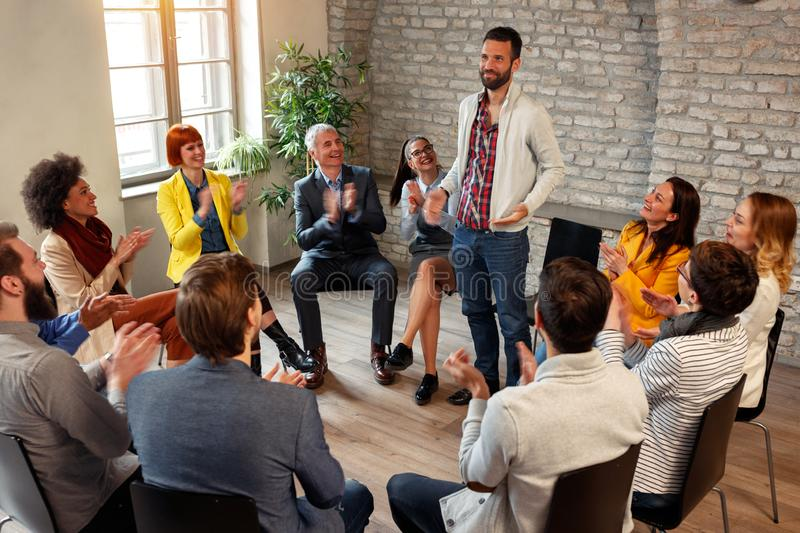 Discussion business group- coworkers applauding man colleagues i. Discussion business group- coworkers applauding men colleagues in group meeting royalty free stock photo
