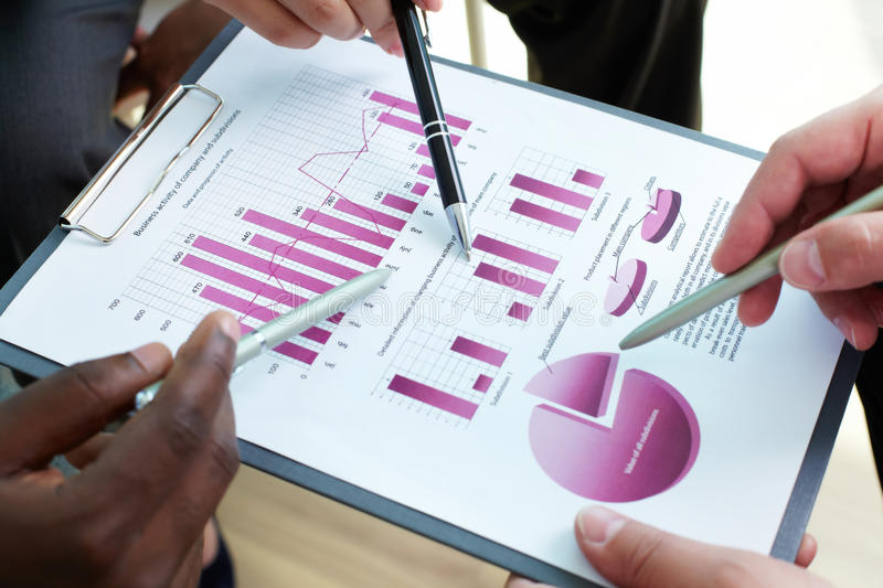 Discussion of document. Close-up of business document being discussed at meeting stock images