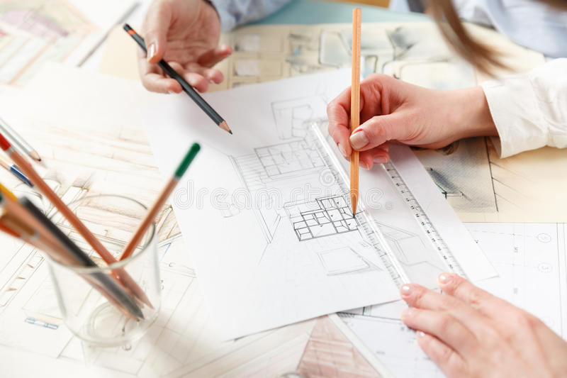 Discussion of interior hand drawings stock images