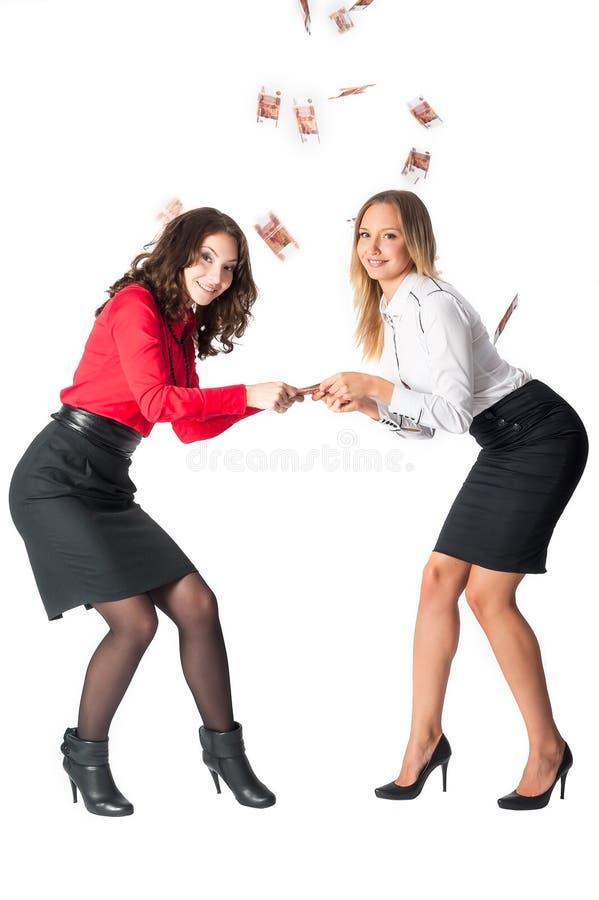 Discutez des jeunes femmes d'affaires attirantes pour l'argent photographie stock libre de droits