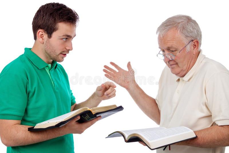 Discutindo a Bíblia imagem de stock