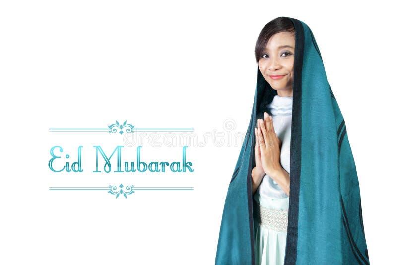 Diseño de Eid Mubarak con la mujer musulmán stock de ilustración