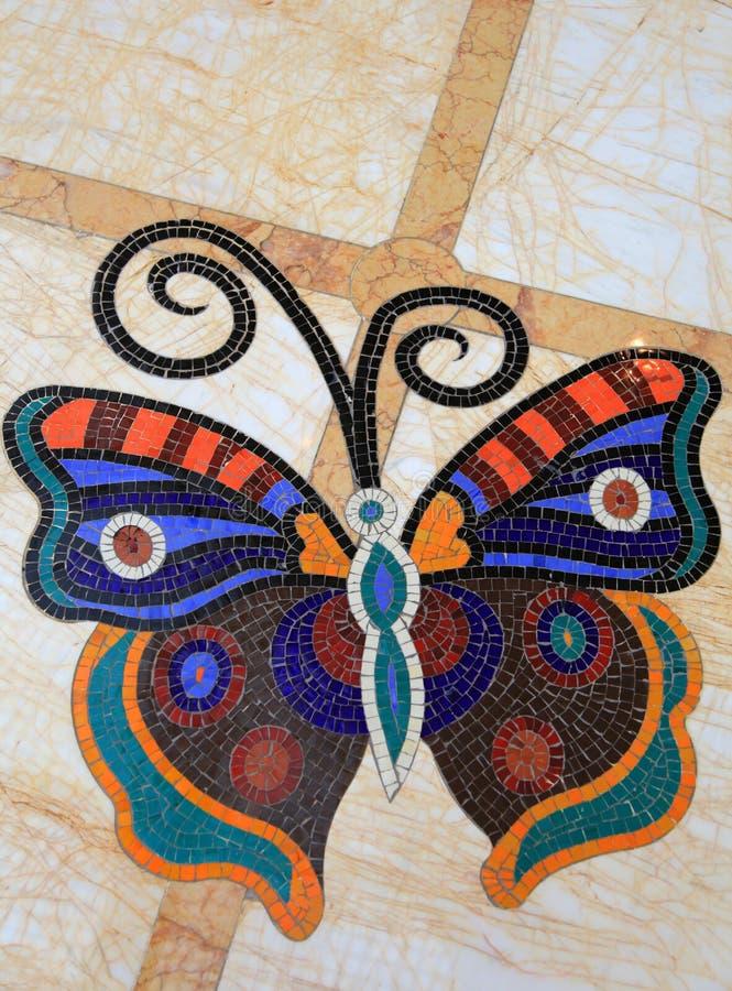 Diseño de la mariposa en el suelo foto de archivo